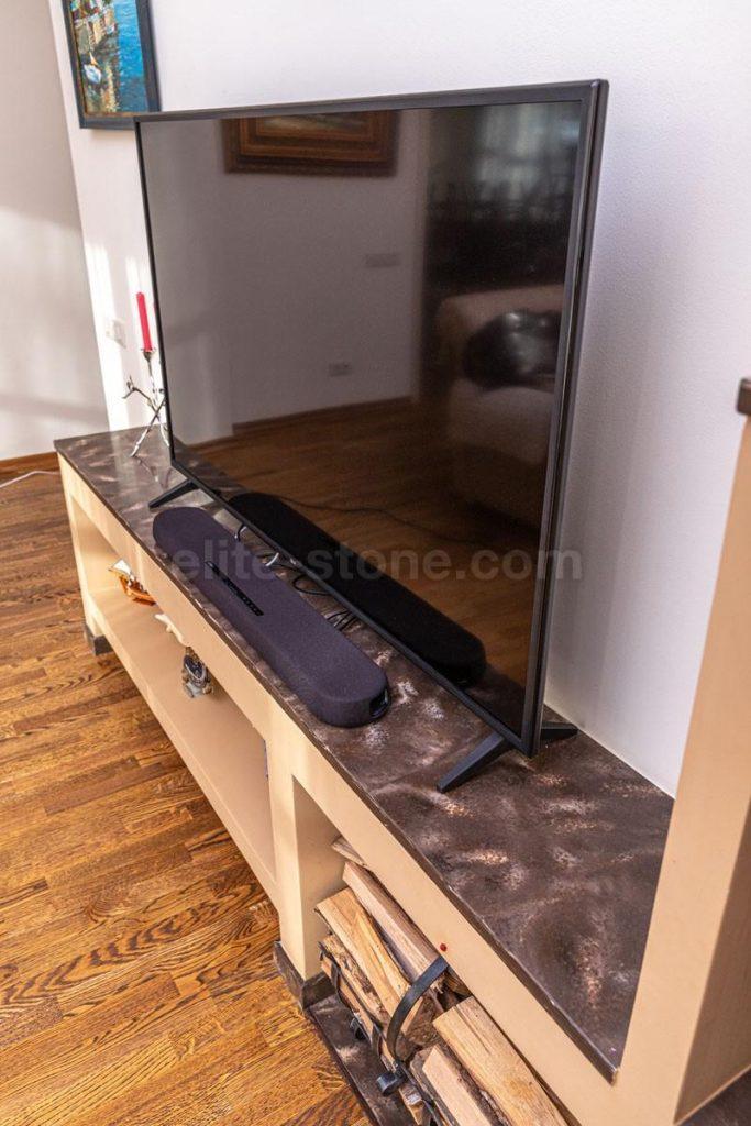 Камин из искусственного камня Hi Macs в гостиной - фото 5
